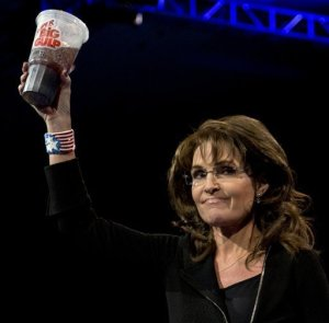 This perfectly framedAP file photo from March 16 shows Palin's eager embrace of red-meat politics that seeks to prevent small measures to address the proliferation of obesity in the United States.