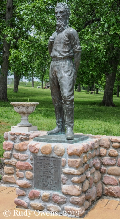 A statue of the abolitionist and revolutionary John Brown stands guard at a park with his namesake in Osawatomie, Kan.