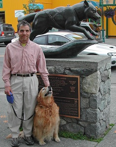 Dr. Roger Gollub and his beloved golden retriever, Sophie, at the famous Balto  statue in downtown Anchorage.
