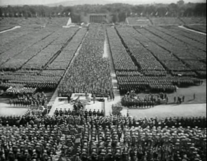 A scene of the Nazis during a rally filmed by Leni Riefenstahl for Triumph of the Will, one the most successful propaganda films ever.