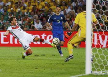 Mario Gotze scores the winning goal against Argentina, as shown in possibly the penultimate game photo of the tournament.