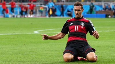 Klose scores his 16th World Cup goal against Ghana, a record and a lasting tribute to a great team player.