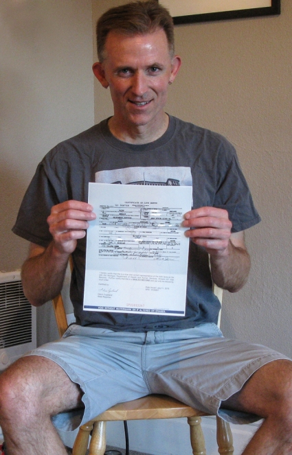 Rudy Owens holds a copy of his original birth certificate (some info whited out intentionally). Michigan denied my human right to my birth record for 27 years. They failed. I did not.